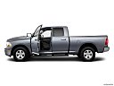 2011 Ram Trucks Ram 1500 SLT Quad, driver's side profile with drivers side door open.