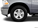2011 Ram Trucks Ram 1500 SLT Quad, front drivers side wheel at profile.