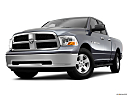2011 Ram Trucks Ram 1500 SLT Quad, front angle view, low wide perspective.