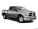 2011 Ram Trucks Ram 1500 SLT Quad, front passenger 3/4 w/ wheels turned.