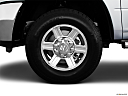2011 Ram Trucks Ram 2500 Laramie Mega Cab, front drivers side wheel at profile.