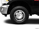 2011 Ram Trucks Ram 3500 DRW Laramie, front drivers side wheel at profile.