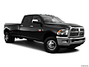 2011 Ram Trucks Ram 3500 DRW Laramie, front passenger 3/4 w/ wheels turned.