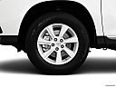 2012 Toyota Highlander, front drivers side wheel at profile.