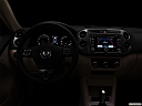 "2012 Volkswagen Tiguan SE w/Sunroof and Nav, centered wide dash shot - ""night"" shot."