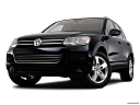 2012 Volkswagen Touareg TDI Lux, front angle view, low wide perspective.