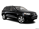 2012 Volkswagen Touareg TDI Lux, front passenger 3/4 w/ wheels turned.