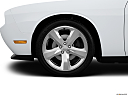 2013 Dodge Challenger R/T Plus, front drivers side wheel at profile.