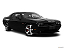 2013 Dodge Challenger SRT8 392, front passenger 3/4 w/ wheels turned.