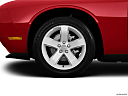 2013 Dodge Challenger SXT, front drivers side wheel at profile.