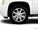 2013 GMC Yukon XL Denali, front drivers side wheel at profile.