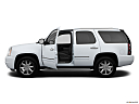 2013 GMC Yukon Denali, driver's side profile with drivers side door open.