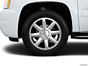 2013 GMC Yukon Denali, front drivers side wheel at profile.