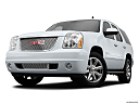 2013 GMC Yukon Denali, front angle view, low wide perspective.