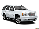 2013 GMC Yukon Denali, front passenger 3/4 w/ wheels turned.
