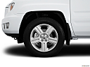 2013 Honda Ridgeline RTL, front drivers side wheel at profile.
