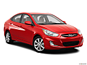 2013 Hyundai Accent GLS, front passenger 3/4 w/ wheels turned.