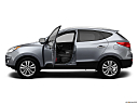 2013 Hyundai Tucson Limited, driver's side profile with drivers side door open.
