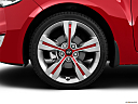 2013 Hyundai Veloster, front drivers side wheel at profile.