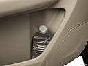 2016 Acura MDX, second row side cup holder with coffee prop, or second row door cup holder with water bottle.