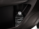 2016 Acura MDX SH-AWD, second row side cup holder with coffee prop, or second row door cup holder with water bottle.