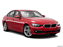 2016 BMW 3-series 320i, front passenger 3/4 w/ wheels turned.