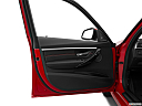 2016 BMW 3-series 328i, inside of driver's side open door, window open.