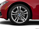 2016 BMW 3-series 328i, front drivers side wheel at profile.