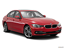2016 BMW 3-series 328i, front passenger 3/4 w/ wheels turned.