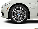 2016 BMW 3-series 330e, front drivers side wheel at profile.
