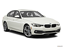 2016 BMW 3-series 330e, front passenger 3/4 w/ wheels turned.