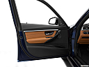 2016 BMW 3-series 340i, inside of driver's side open door, window open.