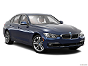 2016 BMW 3-series 340i, front passenger 3/4 w/ wheels turned.