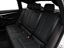 2016 BMW 3-series 328i xDrive Gran Turismo, rear seats from drivers side.