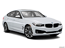2016 BMW 3-series 328i xDrive Gran Turismo, front passenger 3/4 w/ wheels turned.