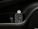 2016 Dodge Durango Limited, second row side cup holder with coffee prop, or second row door cup holder with water bottle.