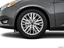 2016 Ford Focus Titanium, front drivers side wheel at profile.