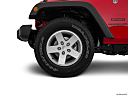 2016 Jeep Wrangler Unlimited Sport, front drivers side wheel at profile.