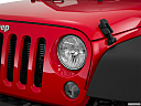 2016 Jeep Wrangler Unlimited Sport, drivers side headlight.