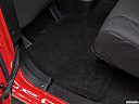 2016 Jeep Wrangler Unlimited Sport, rear driver's side floor mat. mid-seat level from outside looking in.