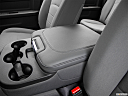 2016 RAM 1500 Big Horn, front center console with closed lid, from driver's side looking down