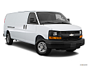 2017 Chevrolet Express 2500 Cargo Extended WT, front passenger 3/4 w/ wheels turned.