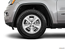 2017 Jeep Grand Cherokee Laredo, front drivers side wheel at profile.