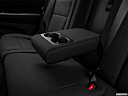 2017 Jeep Grand Cherokee Laredo, rear center console with closed lid from driver's side looking down.