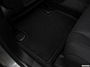 2017 Jeep Grand Cherokee Laredo, rear driver's side floor mat. mid-seat level from outside looking in.