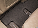 2017 Kia Sedona LX, rear driver's side floor mat. mid-seat level from outside looking in.