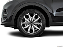 2017 Kia Sportage LX, front drivers side wheel at profile.