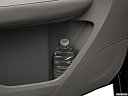 2018 Acura MDX, second row side cup holder with coffee prop, or second row door cup holder with water bottle.