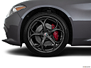 2018 Alfa Romeo Giulia Ti Sport, front drivers side wheel at profile.