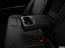 2018 Alfa Romeo Stelvio, rear center console with closed lid from driver's side looking down.